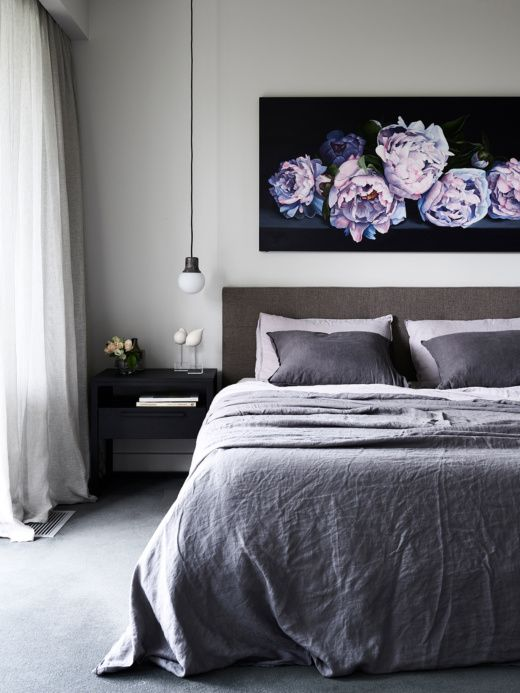 Love the tonal bedding with the painting and the bedside light
