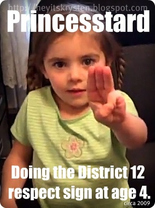 P-tard doing the district 12 respect sign at age 4. :D