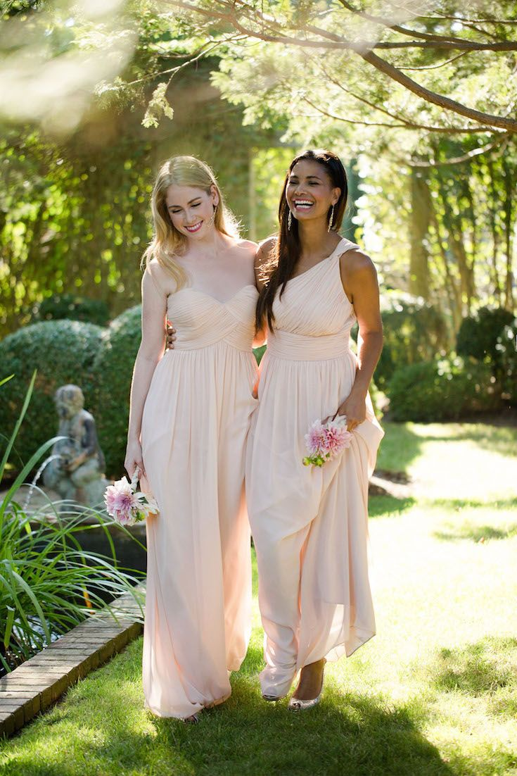 Beautiful complimentary bridesmaids dresses in floaty chiffon by Donna Morgan