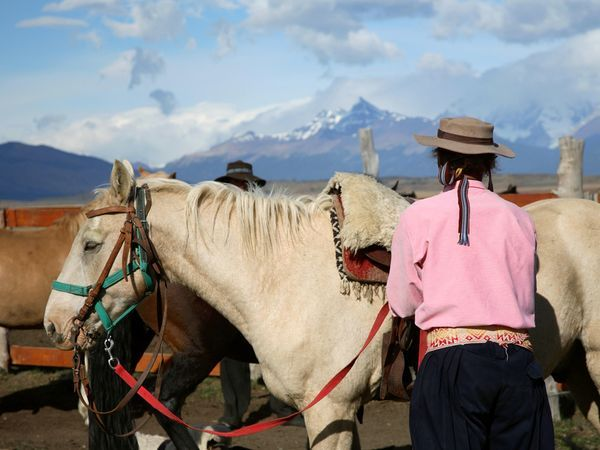 El Calafate    Men and horses pause near El Calafate, a town just beyond Lake Argentina in the southern reaches of Patagonia. With its stunning backdrop of Andes peaks, the town is one of the country's biggest tourist draws.