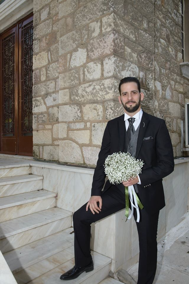 groom with bouquet
