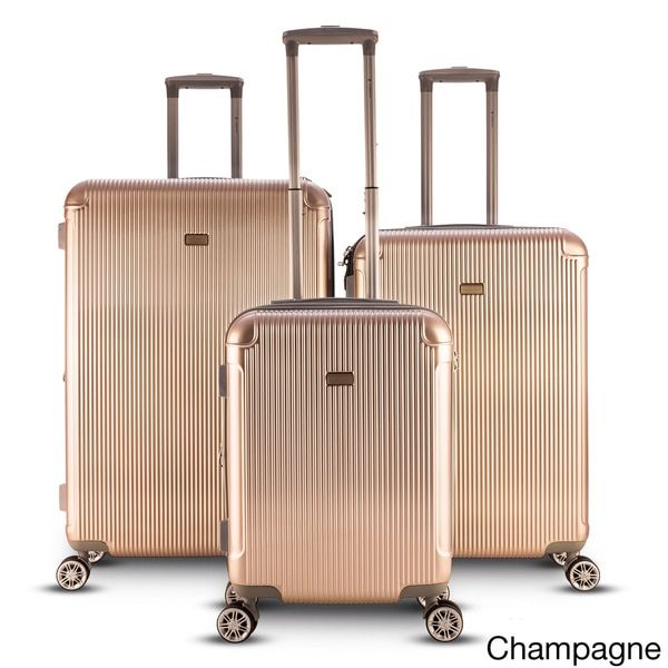 Travel in style when you protect your belongings in this sleek three-piece expandable hardside spinner set. Designed with a classic look, this set includes two uprights and a carry-on in your choice o