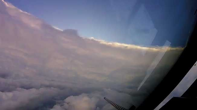 NOAA hurricane hunters fly into the eye of monster Category 5 storm, and it's eerily calm.