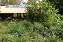 Hut in Bungwahl, Australia. Big horizon, in all seasons: rustic 'chic' slab hut - all re-cyled materials - on 3-acre property on pristine Myall Lake, Myall National Park, NSW. One of only 4 private lake-waterfront properties, just 7-8 minutes drive to Seal Rocks #ryanhut  At...