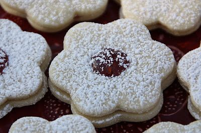 Linzer Tart Cookies  I remember my husband chasing after the bakery truck in Germany when I was pregnant, I had to have this cookies everyday.