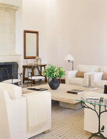 Clean lines fresh neutral living room love this stone table and decor