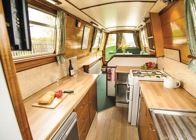The fully equipped galley kitchen aboard one of our Wild Burdock holiday hire boats. #narrowboat   www.calcuttboats.com