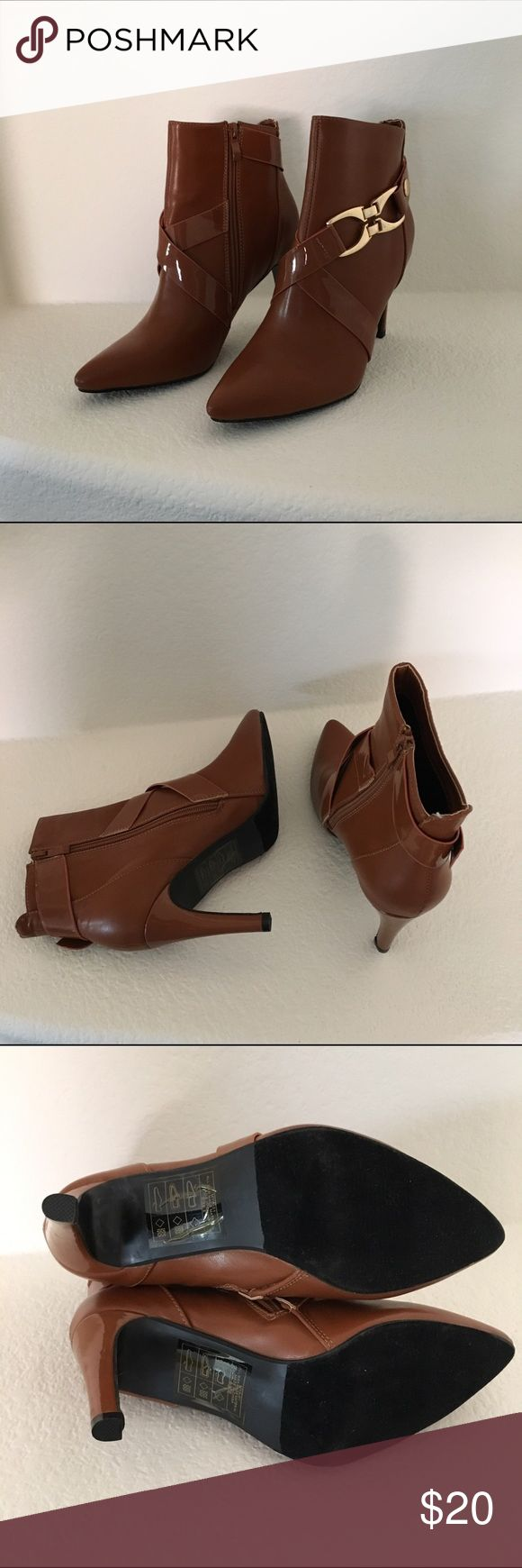 """NWT caramel color ankle boots Brand new caramel color boots by Heart's Collection. Approx 3.5"""" heel. Side zipper. Faux leather. Does not come with box. Slight scratches on metallic buckle (see last photo). Shoes Ankle Boots & Booties"""