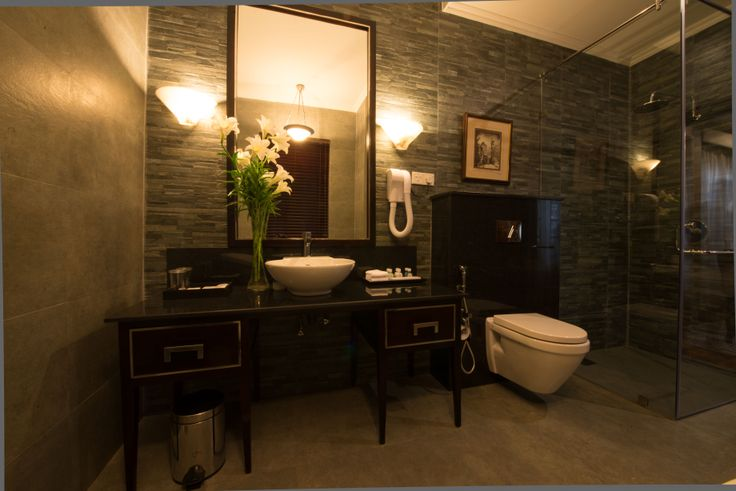 Queen Elizabeth II Suite bathroom.  Clean lines and warm colours continue the elegant feel of the suite.