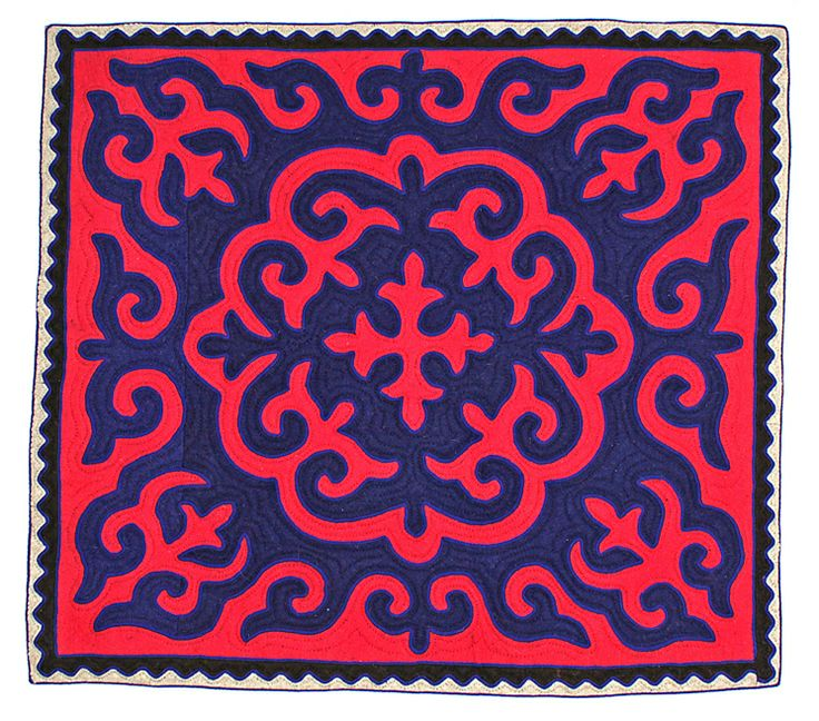 Square Shyrdak rug from Felt in vibrant red and blue, with a black and white border 1.25m x 1.4m feltrugs.co.uk