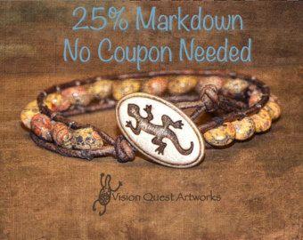 Southwest design leopardskin jasper beads leather wrap stack bracelet. Antique silver lizard design button on distressed gray leather.