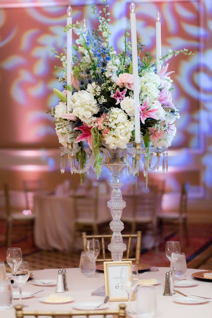 Tall candelabra wedding centerpiece with flowers timelessly elegant indoor ballroom reception at one of our favorite Southern California wedding venues in Los Angeles: The Langham  Pasadena. Swoon! (Michael Anthony Photography)