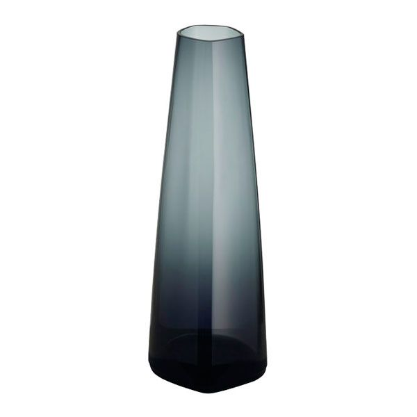 The Iittala X Issey Miyake vase has an elegant, slim shape that is ideal for emphasizing the beauty of a single flower. The vase is made of mouth-blown glass, and its height is 18 cm.