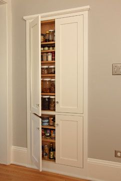 """Tap into stud space for more wall storage - """"If you've got an unused wall in your kitchen, consider using it to store canned goods and jars, as seen here, or stemware, vases and serving pieces. Notice the trim and the door design, which not only conceal the storage but add interest to an otherwise blank wall. Though cost will vary, Deidra Anderson, marketing administrator at David Heide Design Studio, says this project cost $1,300 to $1,900."""""""