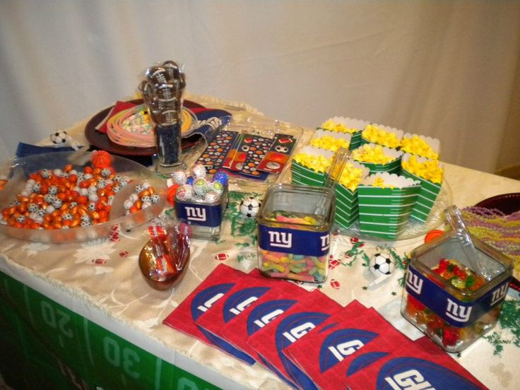 The Super Bowl Theme Giants Candy Table With And Cookies Popcorn Matching
