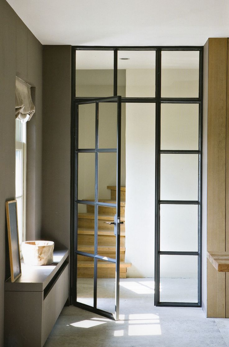 NOTE INTERIOR METAL PASSAGE DOORS. THIS CONCEPT FORMS A SEPARATION BETWEEN TWO AREAS, THOUGH STILL ALLOWING ALL TO FEEL OPEN. THIS COULD BE AN OPTION BETWEEN YOUR MUD ROOM AND HALLWAY.