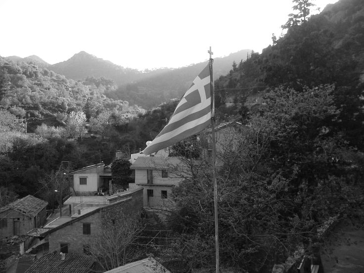 Greek flag flown over valley in the Troodos Mountains, Cyprus.