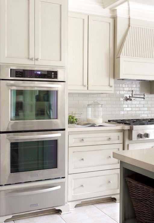 Suzie: Tobi Fairley - Gorgeous kitchen design with off-white ivory shaker kitchen cabinets, ...