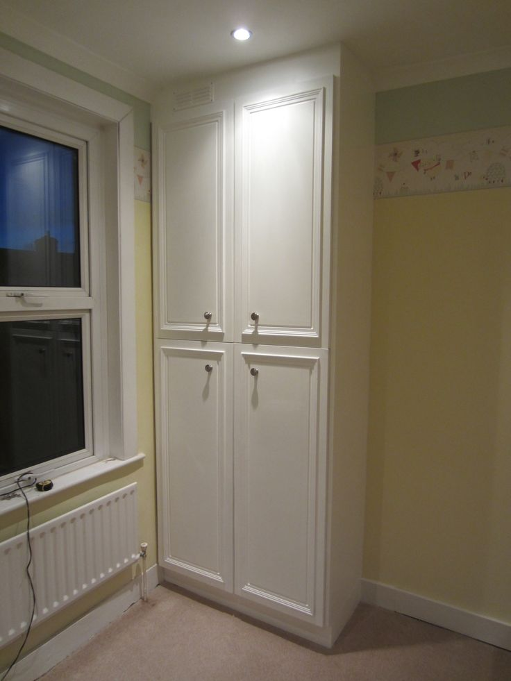 This unit was constructed around an existing boiler for use as an airing cupboard.