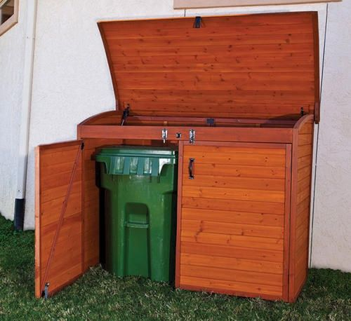 Garbage can shed so they are hidden, the smell is confined, and animals dont get in!