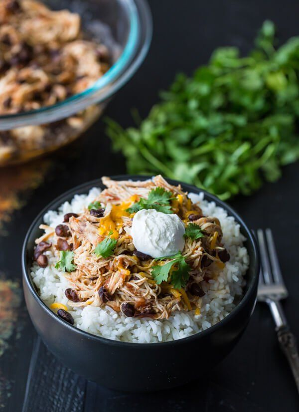 Break out the slow cooker for this easy and flavorful Slow Cooker Salsa Chicken Rice Bowls dish. It's also a review from the cookbook Express Lane Cooking.