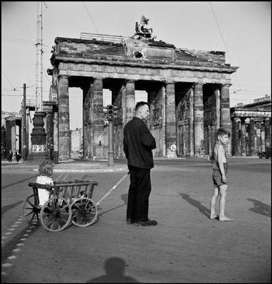germany 1947 berlin a man walking his children near the brandenburg gate by david seymour