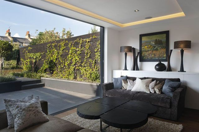 Outside-inside living with an open plan kitchen and communal seating area.