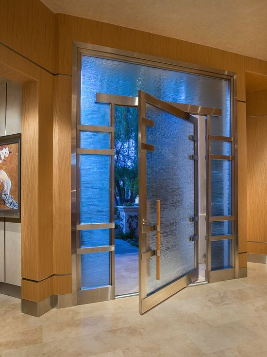 Beautiful Example Of An Entryway Design In Phoenix With A Pivot Front Door