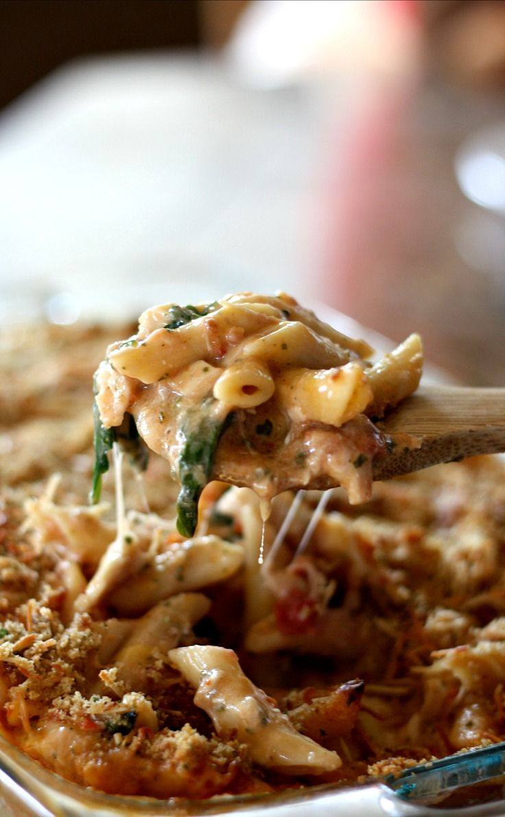 Baked Chicken Pesto Alfredo Freezer Meal- made with chicken, basil pesto, bacon, cheese, spinach and tomatoes mixed together in a delicious white sauce. So good!!