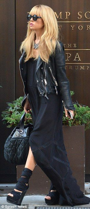 Head-to-toe: Rachel teamed her black dress with a black leather motorcycle jacket and all black accessories