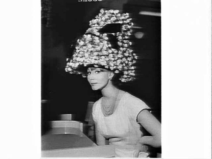 Floral basket hat worn by Del Hancock, hat fashion parade, Farmers department store, 12 Sep 1960.  Find more detailed information about this photograph:  http://acms.sl.nsw.gov.au/item/itemDetailPaged.aspx?itemID=81059  From the collection of the State Library of New South Wales http://www.sl.nsw.gov.au