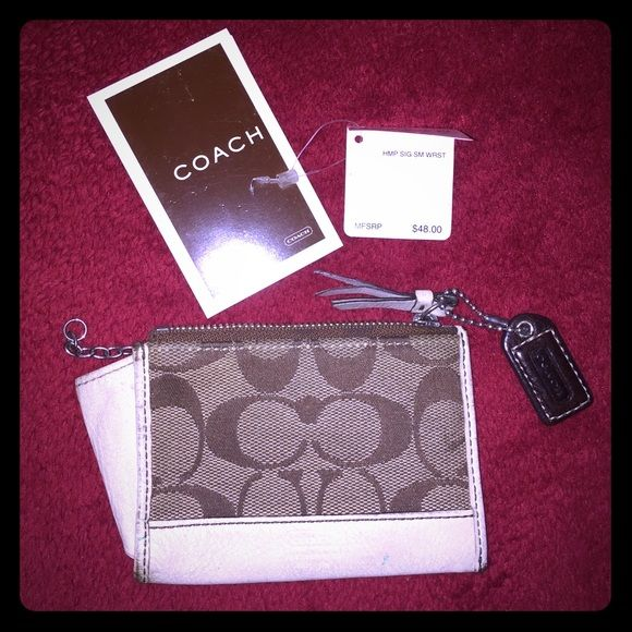 Coach small wallet Coach %100 authentic. It's great for keys an ID credit cards money. I loved this little thing great when I didn't want to carry bags or purses. It's used has some used signs but great item. Comes with tags and a little book that came with when I purchased at Macy's Orange County Coach Bags Wallets