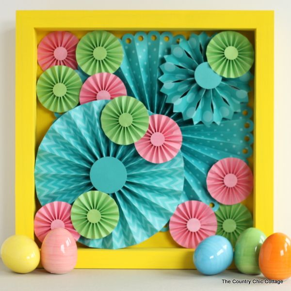 Make this rosette shadowbox art for your home!  Super easy to make with a rosette craft kit!