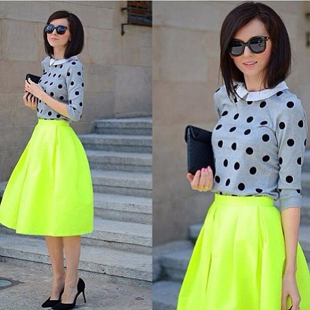 Neon knee length skirt. Blouse and sweater.