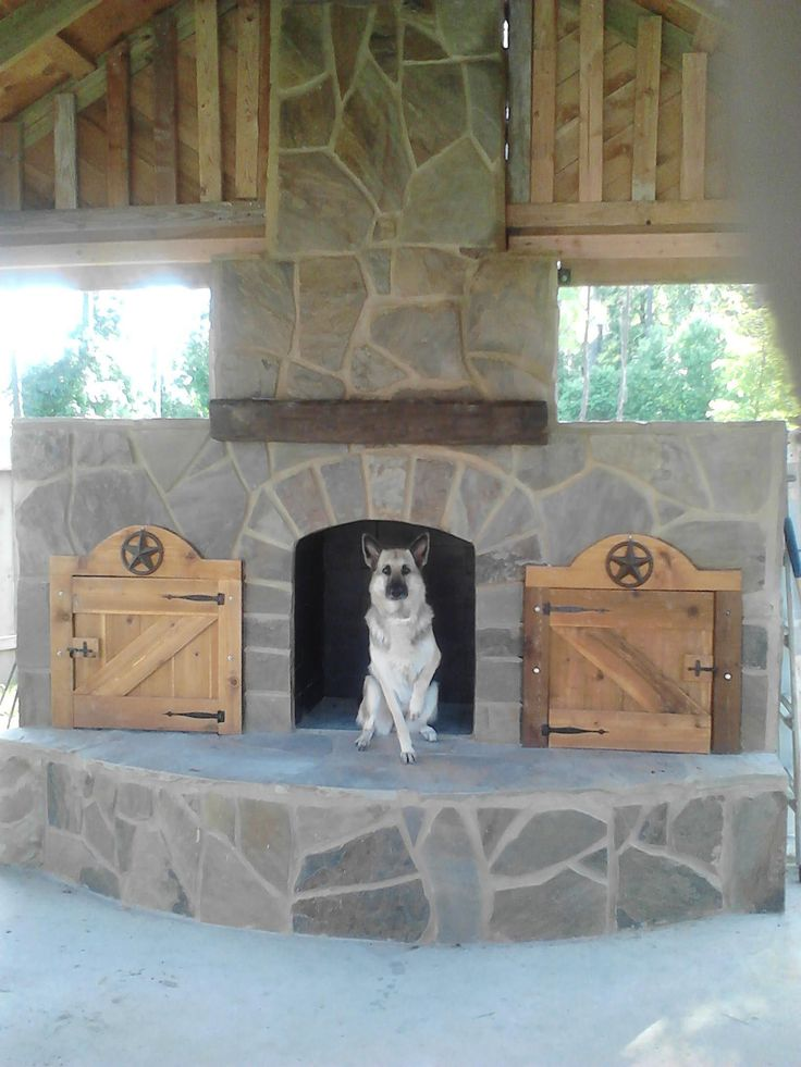 Giant outdoor fireplace under a great pergola.  Even the dog loves it. #outdoorfireplace #outdoorliving #fireplace #diy #outdoorcooking #masonry #outdoor #backyardflare #backyardideas
