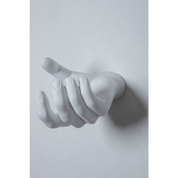 Add unique flair and style to your home with this grabbing hand wall hook.  The resin sculpture is crafted in the shape of a hand with curved and  grasping ...