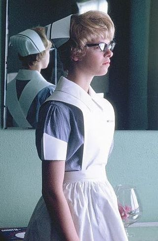 USA Student Nurse, 1964. Love this pose - You can see her and the back of her cap and apron at the same time. It looks like she may have just received her Senior Student stripe, since new probationers getting their first cap, don't get one with a black stripe on it. New caps - in the US anyway - are almost exclusively plain white, unless pastel stripes are used to denote class level, but black stripes generally identify Senior Students and/or Graduate Nurses, depending on the school.