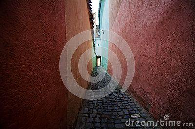 Brasov - Narrow Street by Bogdan Carstina, via Dreamstime