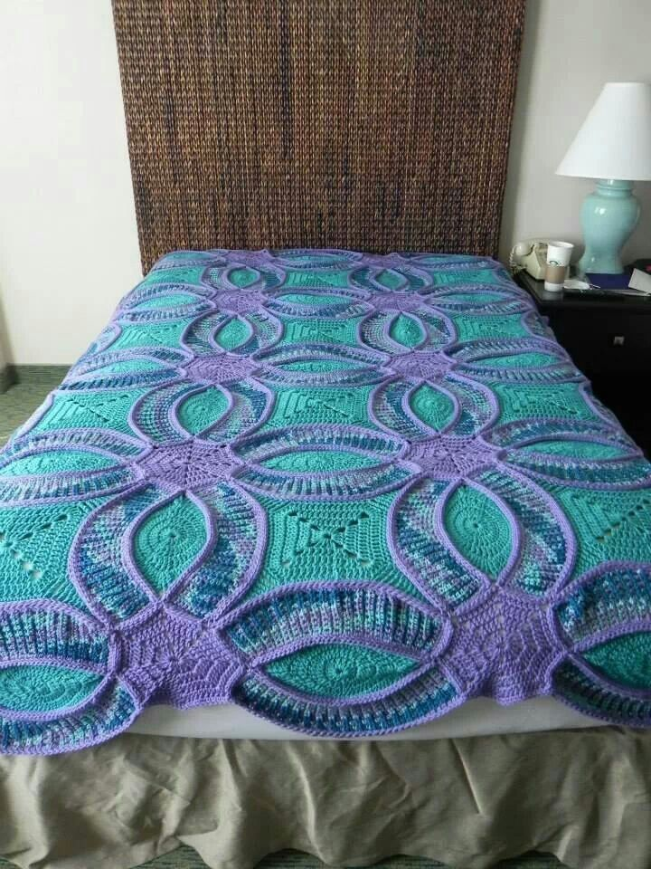 It's a wedding ring pattern in an afghan, instead of a quilt!