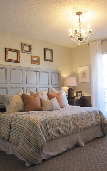 Use An Old Door For A Rustic Chic Headboard.