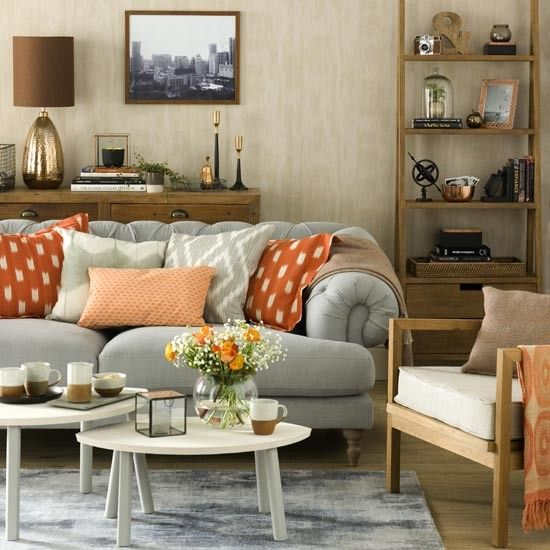 Create a relaxed living room scheme with a palette of neutrals, greys and burnt orange. Keep background colours soft and muted, with neutral walls and pale wooden floors, and take a mix-and-match approach to furniture with a relaxed range of styles. Bring in stronger tones from your palette to layer the effect; try a grey sofa and rug, with accents of burnt orange and copper on throws, cushions and accessories