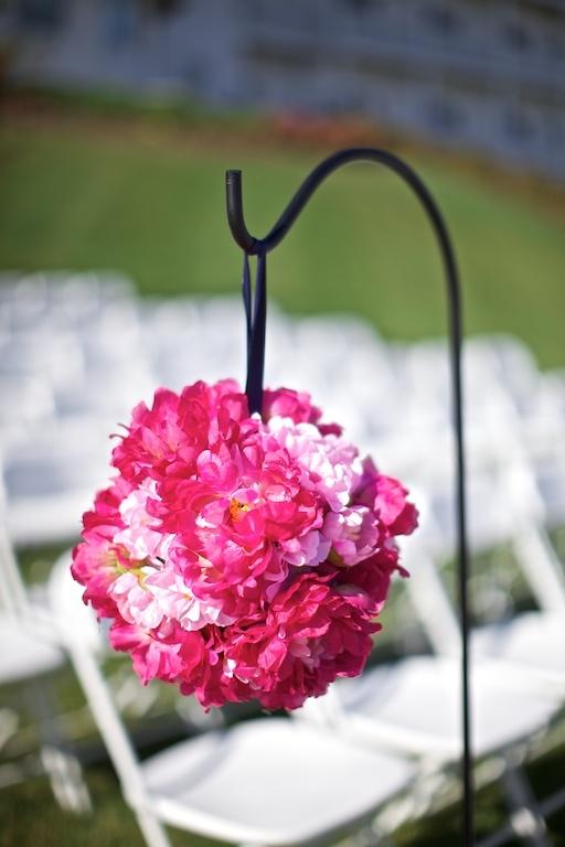 pomander balls from hot pink silk flowers and Styrofoam