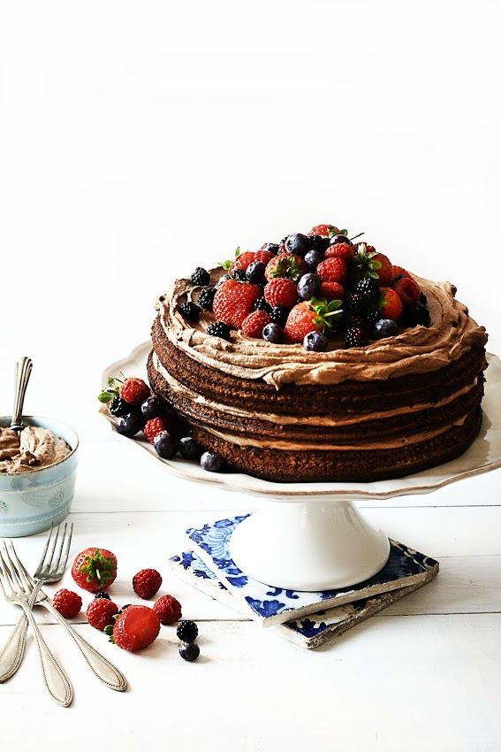 chocolate cake with chocOlate cream frosting and berries