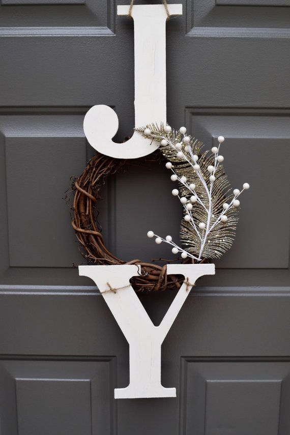 This farmhouse inspired Christmas hanger is the perfect addition to your festive front door! With its rustic touch, this sign gives off an inviting look to your home. This wooden hanger is made of two wooden letters painted and slightly sanded for a rustic look. The letters are waxed to ensure longevity. A 6 rustic branch wreath was added, and lastly a golden feather and white berries to complete the whimsical piece. The Christmas hanger measures at approximately 25 long and 11 wide…