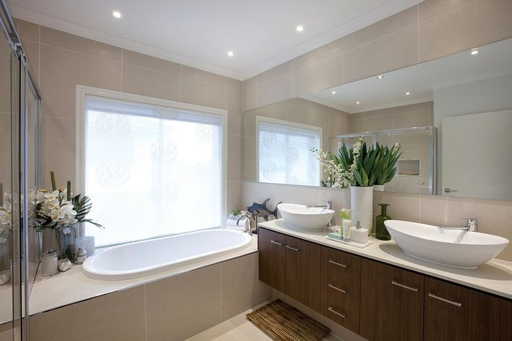 Mmmmmmmmmm I LOVE THIS!  White walls instead of wall to wall tiles, but everything else is perfect.  Beige tiles and counter top, white basin, bath and walls.  Wood cabinet.  BRIGHT, FRESH, WARM!