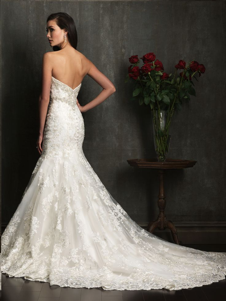 Wedding gown by Allure Bridals 9051 has a stunning lace train.