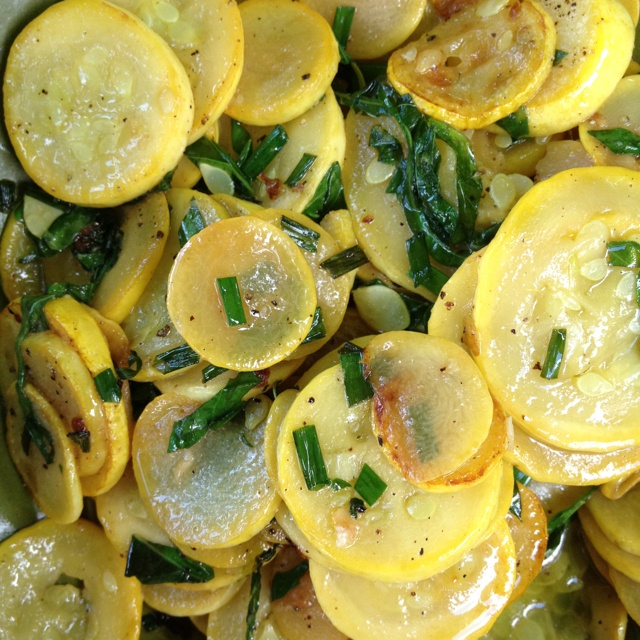 Sautéed summer squash with roasted garlic, chives and basil.