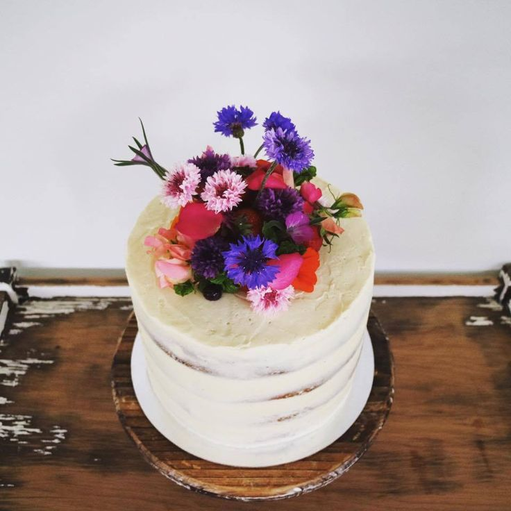 Small one-tier semi-naked Wanaka wedding cake with edible flowers