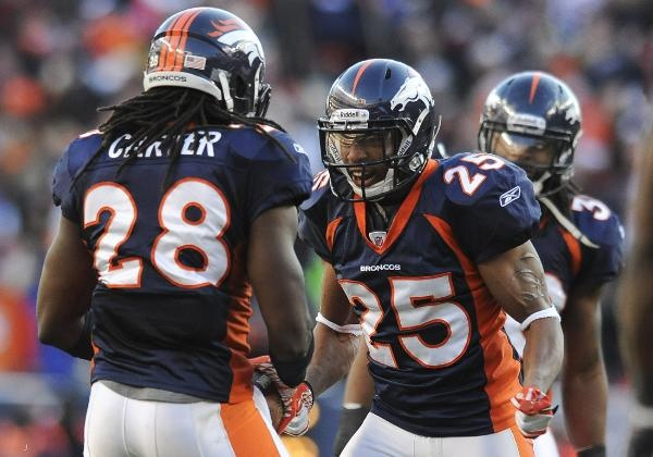 Denver Broncos strong safety Chris Harris celebrates with Denver Broncos free safety Quinton Carter!  Get your Broncos tees here:  http://www.junkfoodclothing.com/webapp/wcs/stores/servlet/Category5_10052_10051_-1_20102_20074_20074_