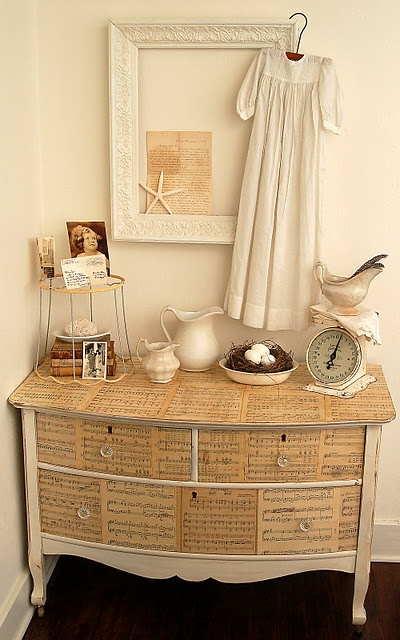 http://missmustardseed.com/2010/03/sytycd-week-4-whites/  I love this dresser covered with antique sheet music. I would probably have  copies made of any vintage music so I  could keep the originals.